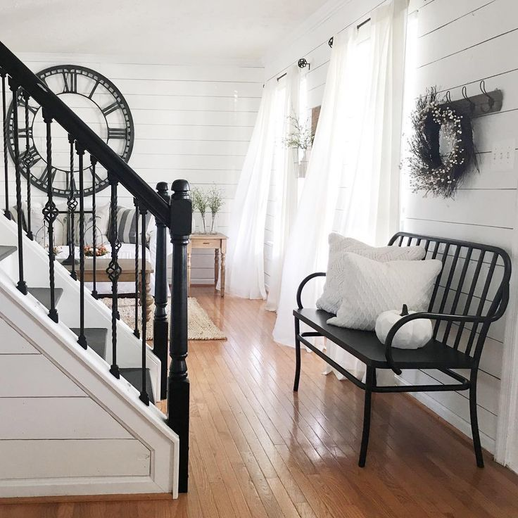 Beautiful farmhouse country entryway with black stair railings #entryway #farmhouse