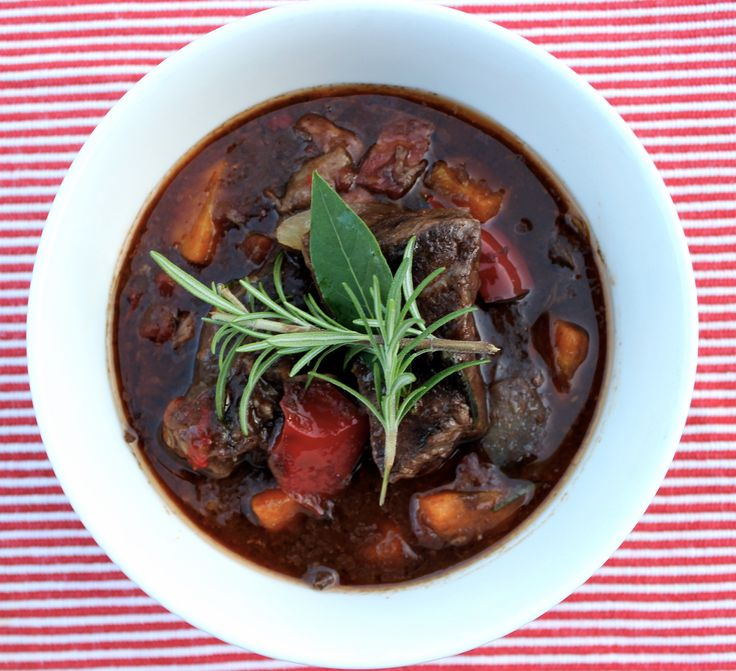 Beef Short Ribs with Rosemary and Red Wine. Throw everything in the slow cooker and enjoy the smell of it cooking throughout the day! www.cookfasteatslow.com
