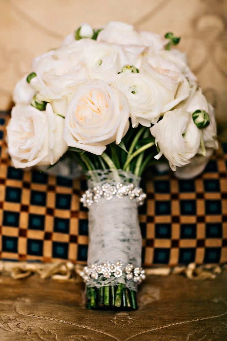 We adore this classically elegant rose wedding bouquet in light pink with a beautiful embellished wrap (Michael Anthony Photography)