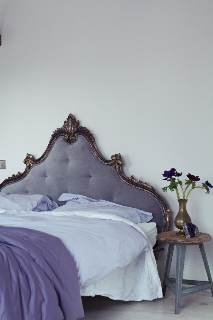 I love the muted tones in this bedroom which are very soothing - London Victorian House, Farrow & Ball Great White, Purple Velvet Headboard | Remodelista