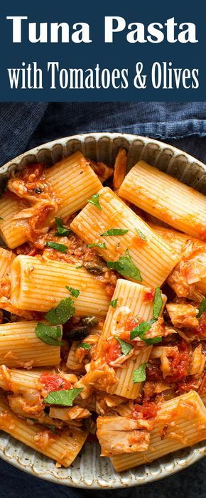 EASY, takes only 30 min! Pasta with sauce of tuna, tomato, garlic, shallots, olives, parsley. Perfect midweek meal. On SimplyRecipes.com