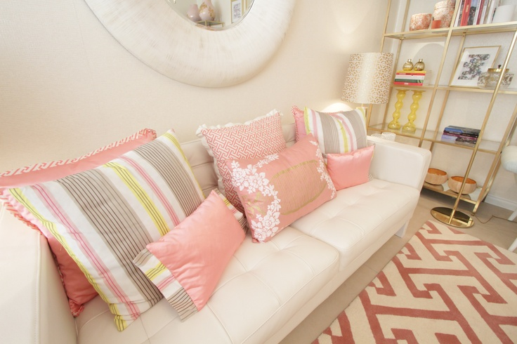 Project by Ana Antunes for the tv home makeover show - Coral geometric fabrics and rug, Mother pearl materials, Big round white mirror, Ikea vittjo shelves painted gold, caitlin wilson fabrics, designer's guild fabrics, pastel shades