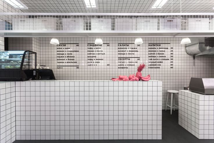 Ukrainian architectural studio AKZ Architectura have covered the interiors of this vegetarian bar in Kiev with a grid of white ceramic tiles.