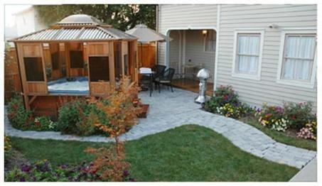 Backyard walkway + jacuzzi