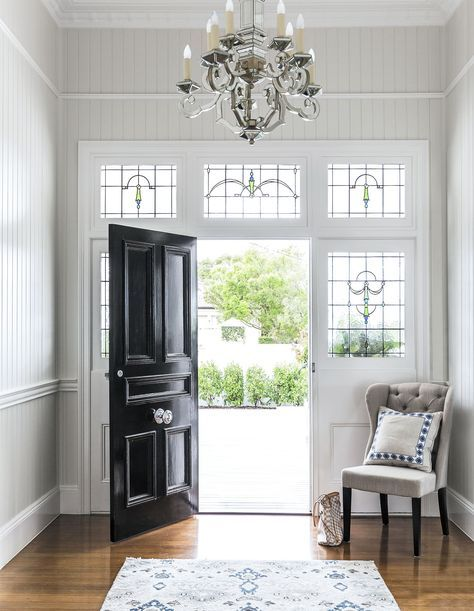 """The vertical panelling so typical in a Queenslander has been painted a crisp, pale grey (Resene Ash, one-eighth strength), which feels contemporary yet works perfectly with the period features. **Chandelier** and **cushion** from [Highgate House](http://www.highgatehouse.com.au/?utm_campaign=supplier/