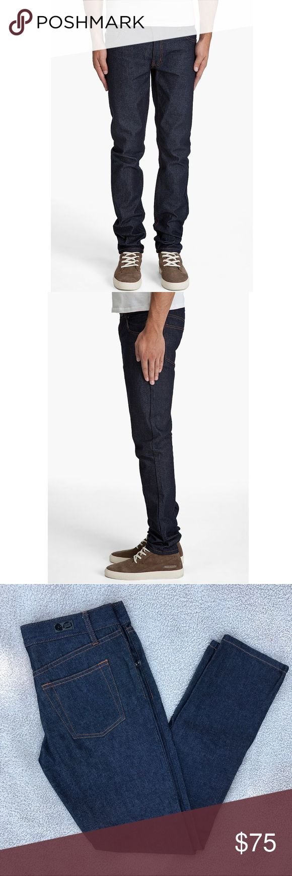 Cheap Monday Staff Boy Dry Jeans Slim fit tapered leg jeans in dark indigo dry denim. Distressed silver tone rivets. Contrast stitching in orange. Zip fly. 100% cotton. Color: blue. New without tags Cheap Monday Jeans Slim