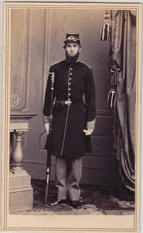 Civil War soldier from California. Probably perished in battle. Close examination shows a barely-visible stand holding him up. Left hand is in unnatural position, and face is devoid of expression.