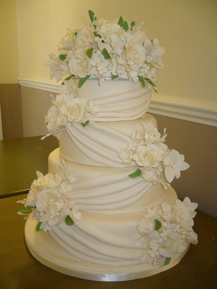 4 tier wedding cake with sugar flowers four tier ivory wedding cake with diagonal sugarpaste 10425