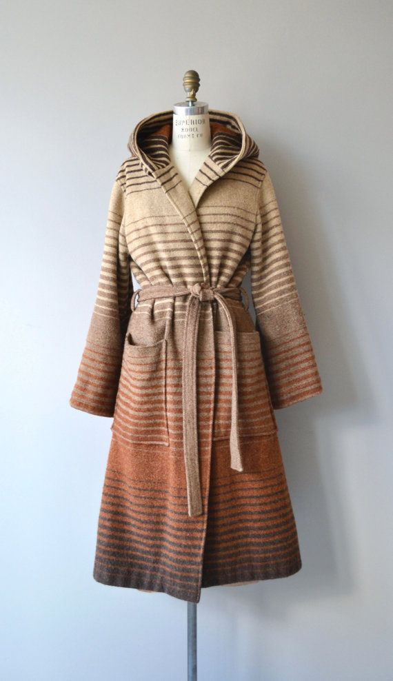 Vintage 1970s Luba wool wrap coat with ombre stripe, large pockets, attached hood and tie belt. No lining. The coat does button at the top as well, shown with collar open.  --- M E A S U R E M E N T S ---  fits like: fits most shoulder: 17 bust: up to 49 waist: ties to fit hip: free sleeve inseam: 19: shoulder to cuff (cuff is adjustable in width): approx. 30 length: 47 brand/maker: Luba condition: excellent  ✩ layaway is available for this item  ➸ More vintage coats…