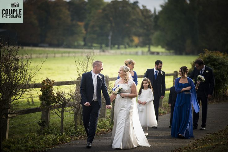 The bridal party among the gorgeous colourful autumnal trees. Weddings at The Heritage Hotel by Couple Photography.