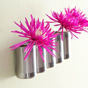 Canned Art - Don't throw out cans once you've finished their contents -- instead, decorate with them. The shiny metal and ribbed pattern give these wall-mount vases a modern industrial look. Drill holes in the sides of the cans and join them together with bolts. Add a few holes in the top backs for hanging. Use these recycled cans as vases or over a desk for office supplies.
