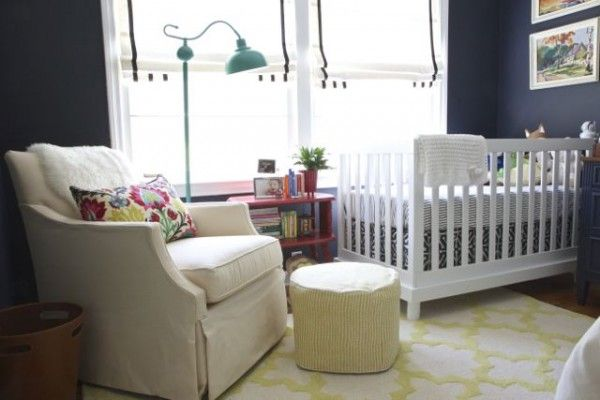Gorgeous Deep Navy colored baby nursery designed by Molly from The Nesting Game! This room is stunning with pops of yellow and floral. Featured on Design Dazzle