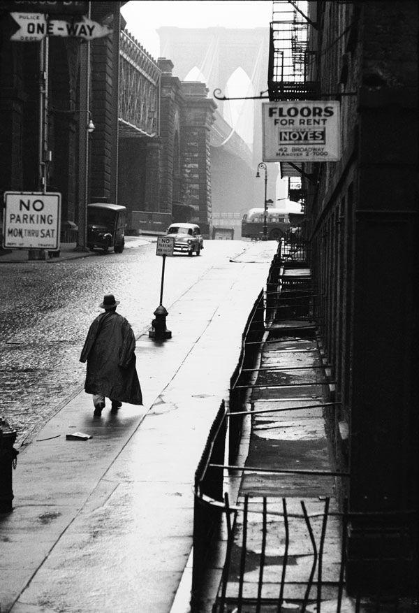 Erich Hartmann - Man in street under the Brooklyn Bridge, USA. New York City, 1955.