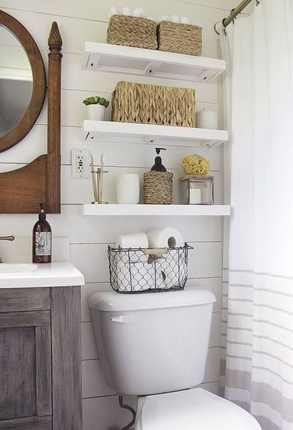 Shiplap Wall in master bathroom with Shelves Over Toilet.