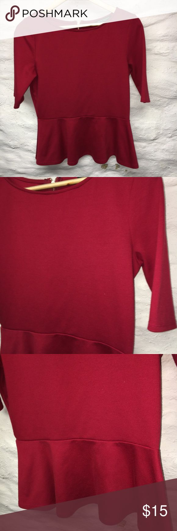 Green envelope red peplum Blouse medium Cute peplum Blouse, size medium, gold colored Zipper Back, has some minor pilling. Preowned with lots of life left! green envelope Tops Blouses
