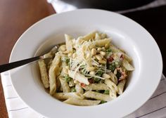 Boursin Pasta recipe - Boursin garlic and fine herb cheese, peas, green beans, asparagus, spinach, broccoli, garlic, chicken broth, wine, sundried tomatoes, dill, Parmesan, pine nuts. #vegetarian #pasta #herbs