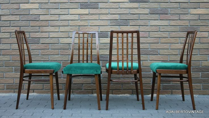 A set of four Czechoslovak chairs from the 60s by TON after professional restoration. The emerald fabric on the seat gives them the most fashionable look.