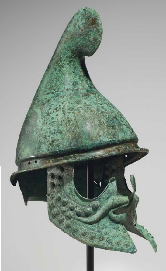 A GREEK BRONZE HELMET OF PHRYGIAN TYPE   LATE CLASSICAL TO EARLY HELLENISTIC PERIOD, CIRCA 350-300 B.C.