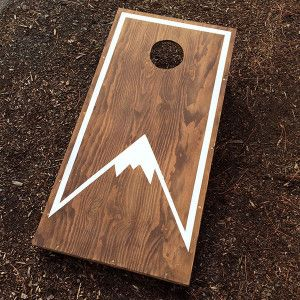 Peak mountain cornhole set for rent in Oregon from ae creative
