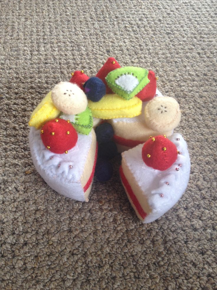 crafty felt cake - my Japanese sister-in-law hand sewed this most marvelous play craft object for her 2yr old daughter (my niece). there is red velcro used to stick the slices together. It is art.