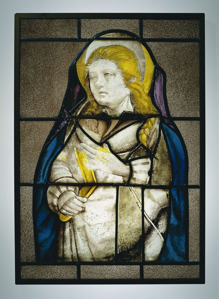 Anonymous | Ruit met een heilige met aureool, Anonymous, c. 1515 | Heilige met aureool om het hoofd, een gesloten boek onder de rechterarm; de linderarm is betogend vooruit gestoken. Het lange haar eindigt in een vlecht.