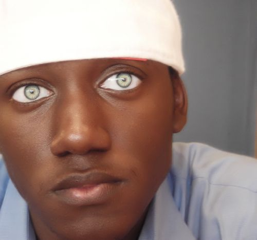 Those light green eyes in contrast to his dark skin...so beautiful.