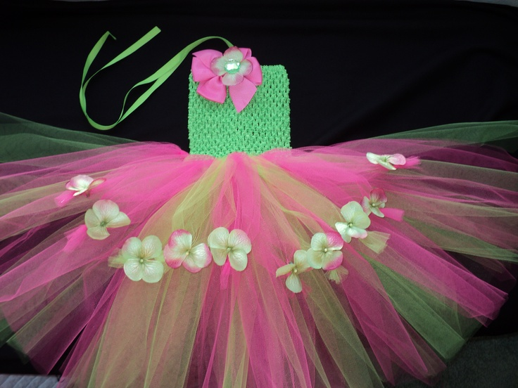 """Perfect colors for a summer wedding in the garden..bright green and shocking pink with little pink and green hydrangea flowers and a shocking pink clip on flower & rhinestone bow.  $18.95 shipped.    This has a crochet tube top with lime green and shocking pink tulle with an extra layer of knotted tulle in the front for a little flower """"apron"""" effect."""