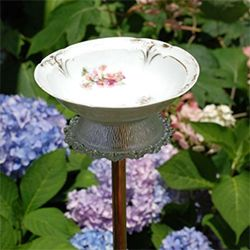Check out this DIY tutorial on how to make this cute bird bath for your garden.
