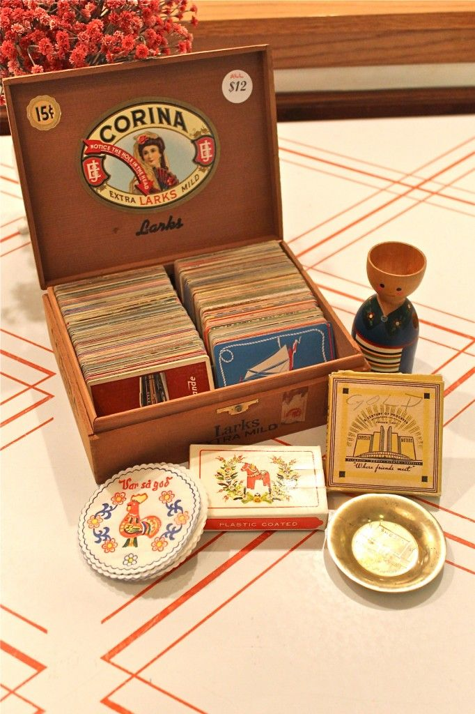 $4.50 @ Brie's Estate Sale - 500+ vintage playing cards in cigar box, scandinavian coasters and dala horse deck, 1933 souvenir ash tray, and wooden egg cup.