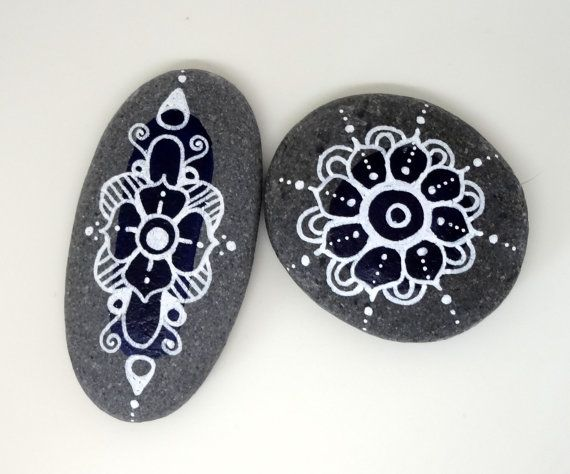 This listing is for 2 mandala stones. There is a navy blue background and white hand drawn mandala. These stones are sealed but not meant to be wet for extended periods of time and are intended for indoor display.    What is a mandala?  Mandala is a Sanskrit word meaning circle. Mandalas have spiritual and ritual significance in Hinduism and Buddhism. Mandalas often exhibit radial balance. In various spiritual traditions, mandalas may be used for meditation.    In common use, the word…