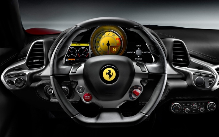 The dynamic cockpit of the Ferrari 458 Italia incorporates the optimum amount of knowledge that the venerable Italian automobile maker has gleaned on the Formula One racing curcuit. The steering wheel for example looks remarkably like that utilized in their F1 Race Cars.
