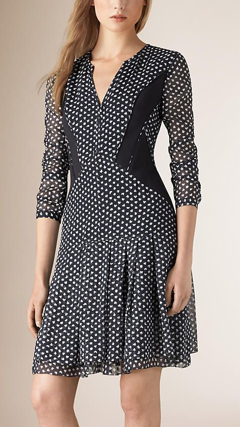 Burberry Navy Printed Silk Dress with Contrast Panels - A silk dress featuring a leaf print. Complementing the feminine silhouette, the dress is designed with panel detailing and sheer sleeves.