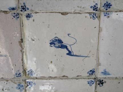 Antique Delft tile lion