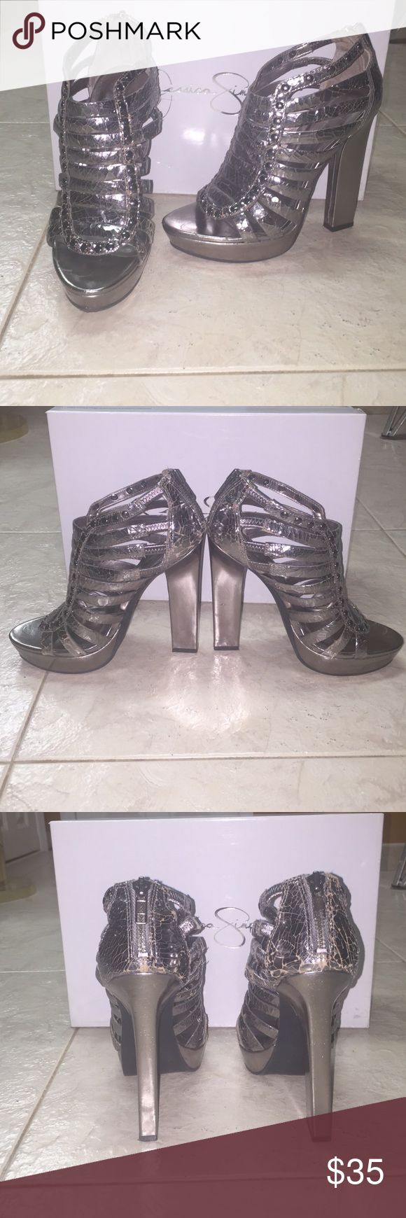 Jessica Simpson Metallic strappy high heels Jessica Simpson Pewter Metallic strappy high chunky heels with zipper back. Cracked leather affect with studs - some areas are more cracked than others. Comes in box Jessica Simpson Shoes Heels