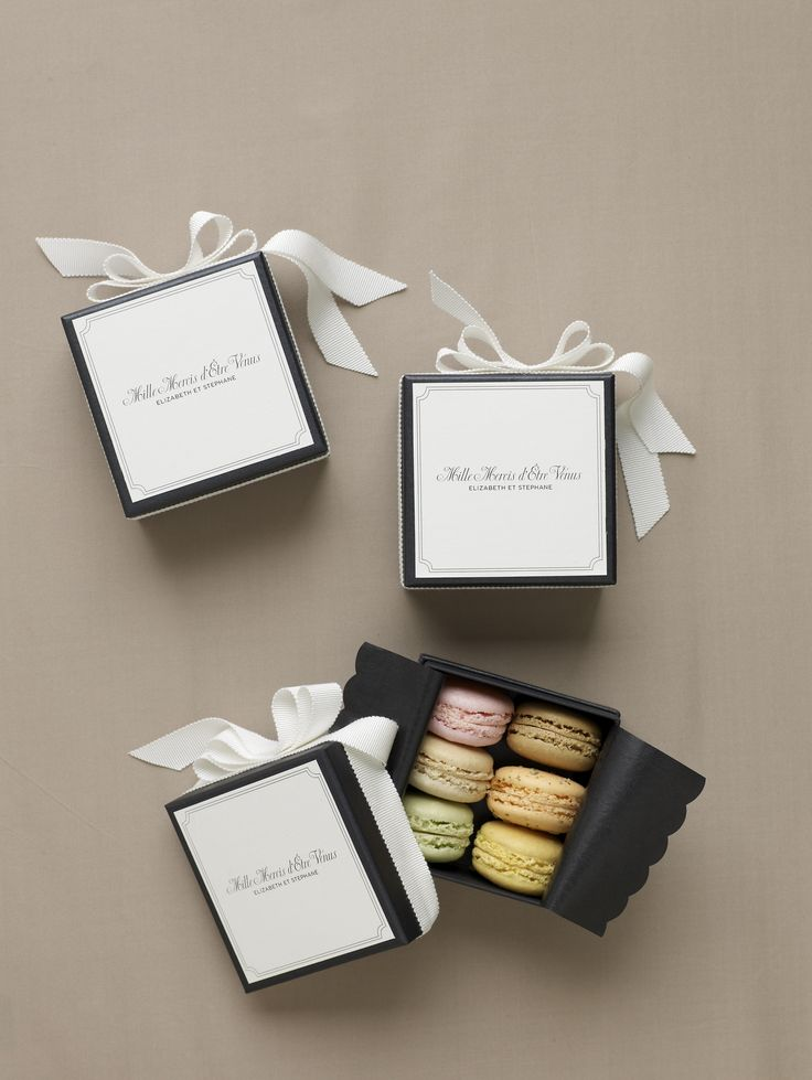Yum, macaroons for the favors in the classic white and black boxes