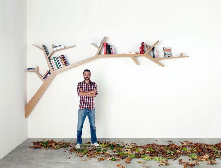 Branch by French Designer Olivier Dollé is a one of a kind bookshelf-piece that is composed of over 80 pieces of birch plywood and veneered oak wire. Both aesthetic, poetic, functional and sculptural, this bookshelf comes in two different sizes (3,2 m - 10 1/2 ft and 4,2 m - 13 3/4 ft wide). Branch is also available in walnut and other types of wood upon request.       Photos by: Nicolas Scordia