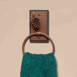 We offer this Iron 3D Pinecone Towel Ring and other fine rustic iron décor.