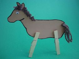 I have done this with my preschool storytime group at the library.  Super fun, and you can embellish your little horses in so many ways!  I'm using craft foam sheets for the body and feathers for the mane and tail this time.