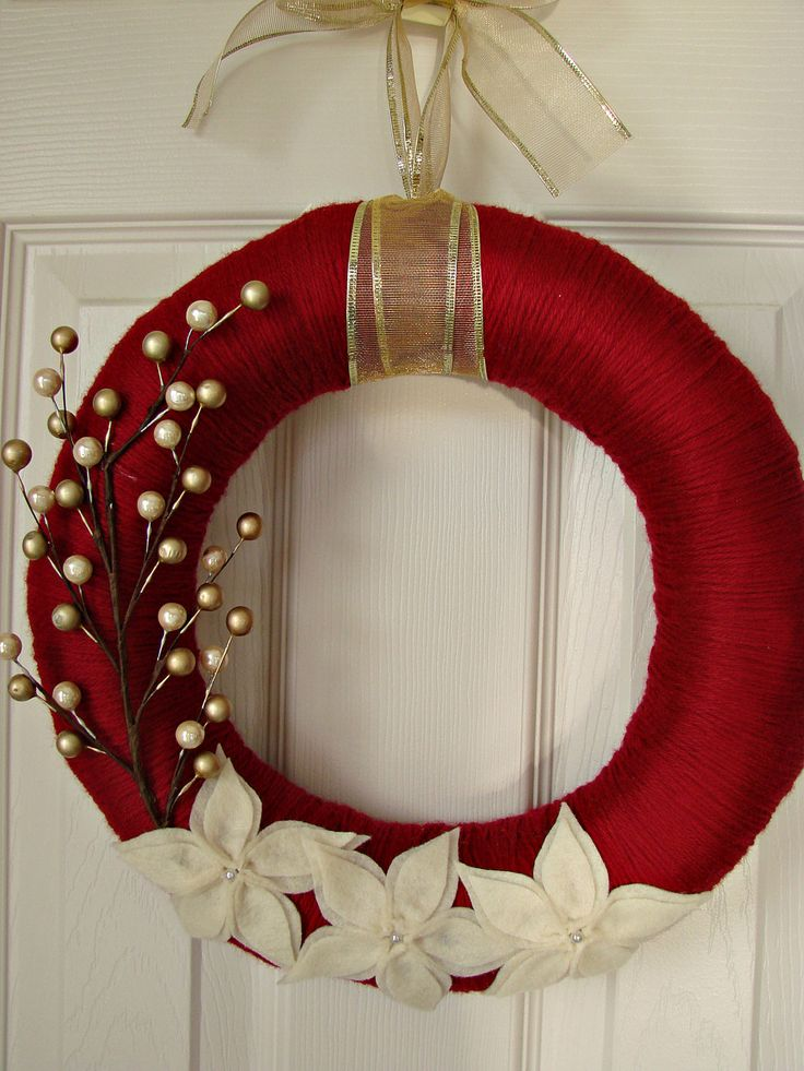 Dark red yarn wrapped wreath with 3 layer poinsettia. $30.00, via Etsy.