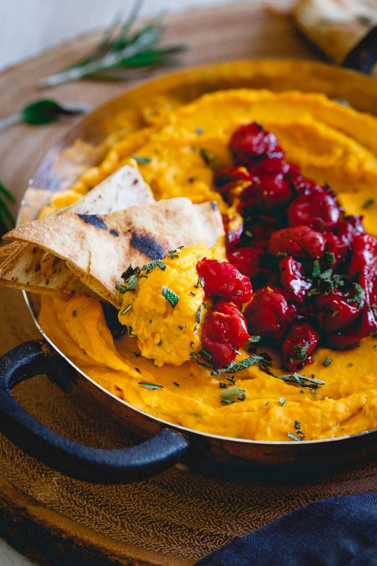 This butternut squash dip is made with goat cheese and cream cheese for a super creamy texture then topped with a festive Montmorency tart cherry compote. Serve it with some pita chips for the perfect holiday appetizer!