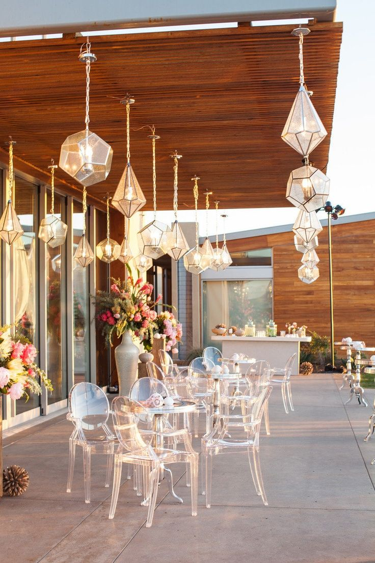 Etherial sparkle on a big patio. I would do something different with the floral arrangements as they appear to conflict with the rest of the look.