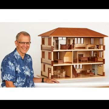 Man with doll house