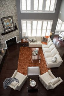 Good couch placement for a corner fireplace, orange rug has to go though