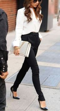 Simple white and black business attire for the fashion forward business woman, edgy/sharp shape