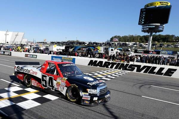 Darrell Wallace Jr. crosses the finish line to win the NASCAR Truck Series race at Martinsville Speedway.
