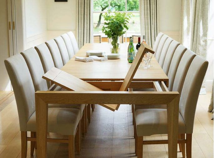 found here : http://www.berrydesign.co.uk/extending-dining-tables/infinity-extending-dining-table