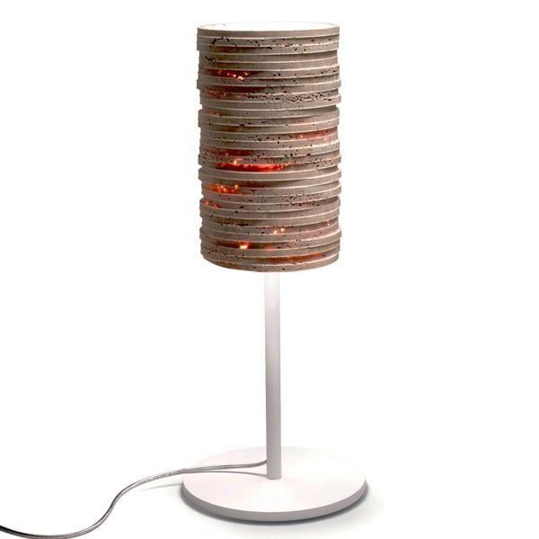 The exclusive Strato table lamp was designed by Raffaello Galiotto for Marmi Serafini. Made in Italy, Strato is made of natural travertine stone, atop a modern, slim base in steel.