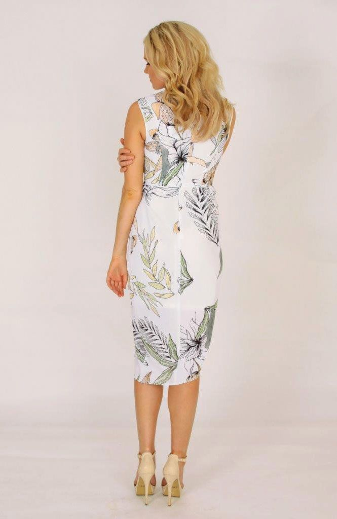 Palm Cove V-Neck Dress - Shop vacation-ready styles at TRAVELLERS' ROBE – Our Palm Cove V-Neck Dress features a gorgeous fern botanical print, with neutral tones on beautifully lightweight, white fabric. This dress features a front gathered design, with invisible zipper closure on back. Length falls around the knee, with front split. Dress is lined with shorter-length stretch lining. Shop it now, xo.