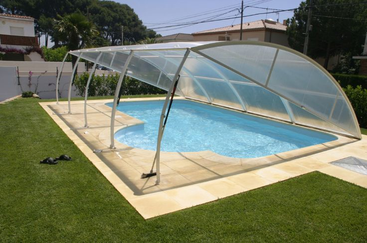 This pool cover is unique and does not really fit into any typical category. It is a retractable dome with hinged arms. This is an interesting and creative solution to pool covering.