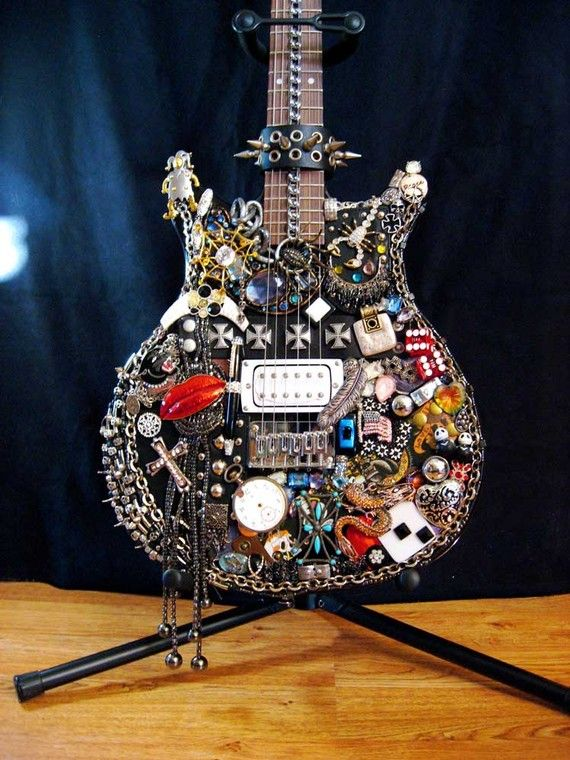 I Love Rock and Roll Black Electric Guitar by ArtCreationsByCJ..this is soo cool, i wanna start saving old but cool jewelry and things and evenually find an old guitar to do this with and hang it up wherever our music area will be!